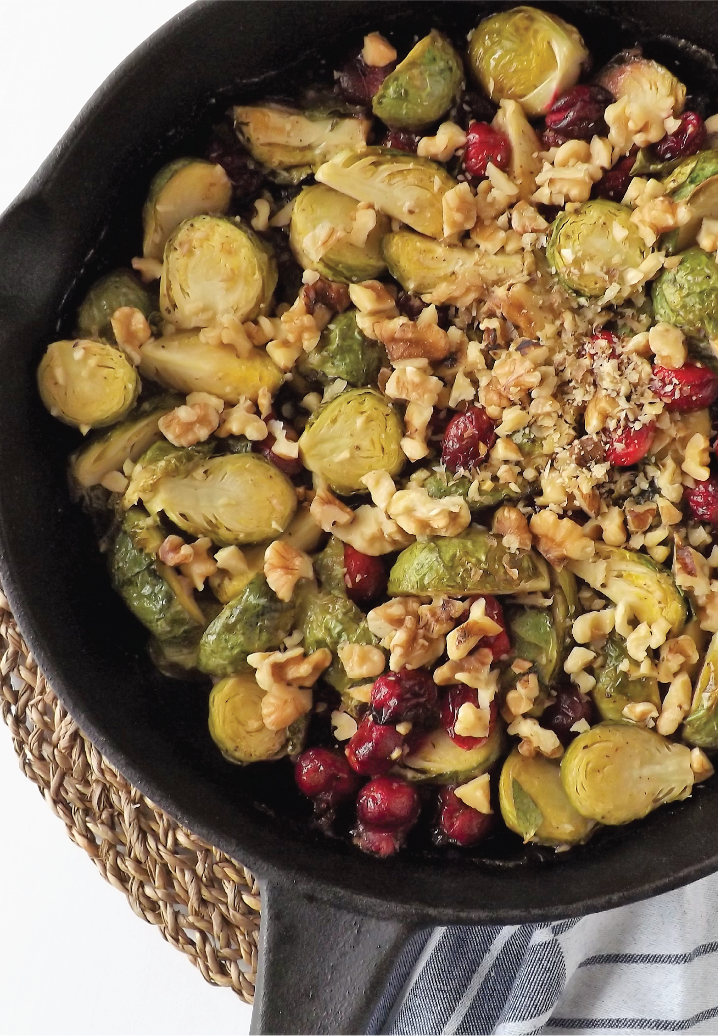 Finished pan of roasted brussel sprouts with maple, dijon, cranberries and walnuts.